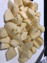 First step... chop the potatoes to boil.